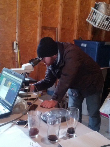 Ronn gives the yeast a final once-over and count before pitching.