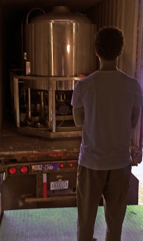 Dan gazes at the brewhouse and contemplates our situation