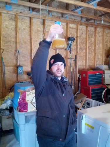 Ronn inspects some home-grown yeast
