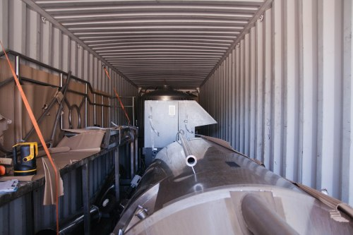 The brewhouse nested in the back of a shipping container