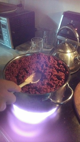 Making sumac extract.
