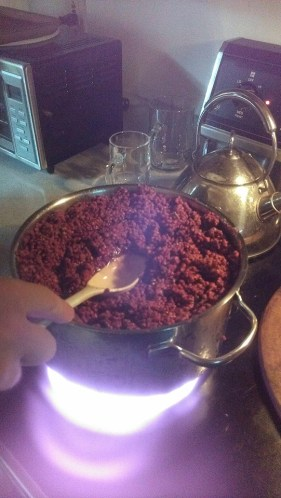 Making sumac extract.